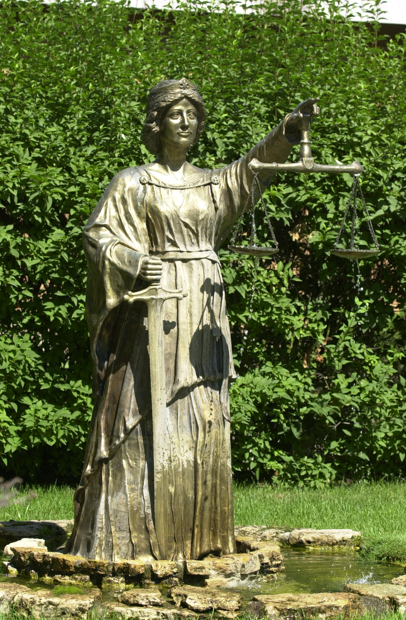 """Lady Portia, Goddess of Justice"", bronze fountain, life-size, Maplewood, MN, 1987...my first sculpture and the life-changing moment of career transition from architectural designer to sculptor and artist. (photo by Dave Hrbacek)"